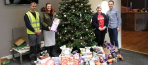 The Spaciotempo team presenting festive donations to Paul Jones at the Renew Church Food Bank in Uttoxeter.