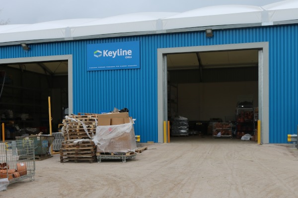 The exterior of the temporary warehouse at Keyline Exeter, featuring cornflower blue cladding and goosewing grey flashing.