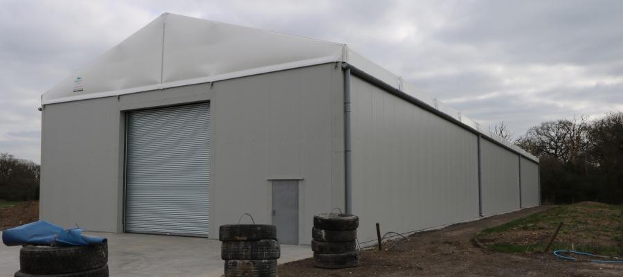 The exterior of Oakland International's Neivalu-style temporary warehouse.