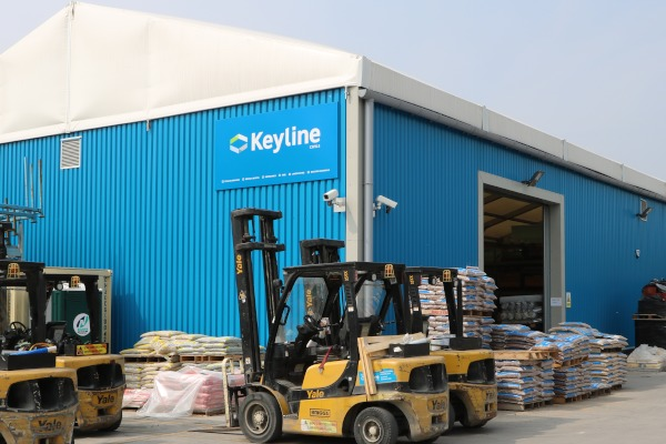 An external photo of the bespoke blue warehouse at Keyline in Leeds